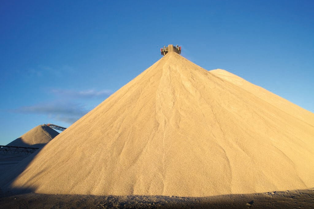 Enormous sand-colored pyramids of material