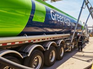 "A ""Greenergy"" truck being filled with sustainable used cooking oil fuel."