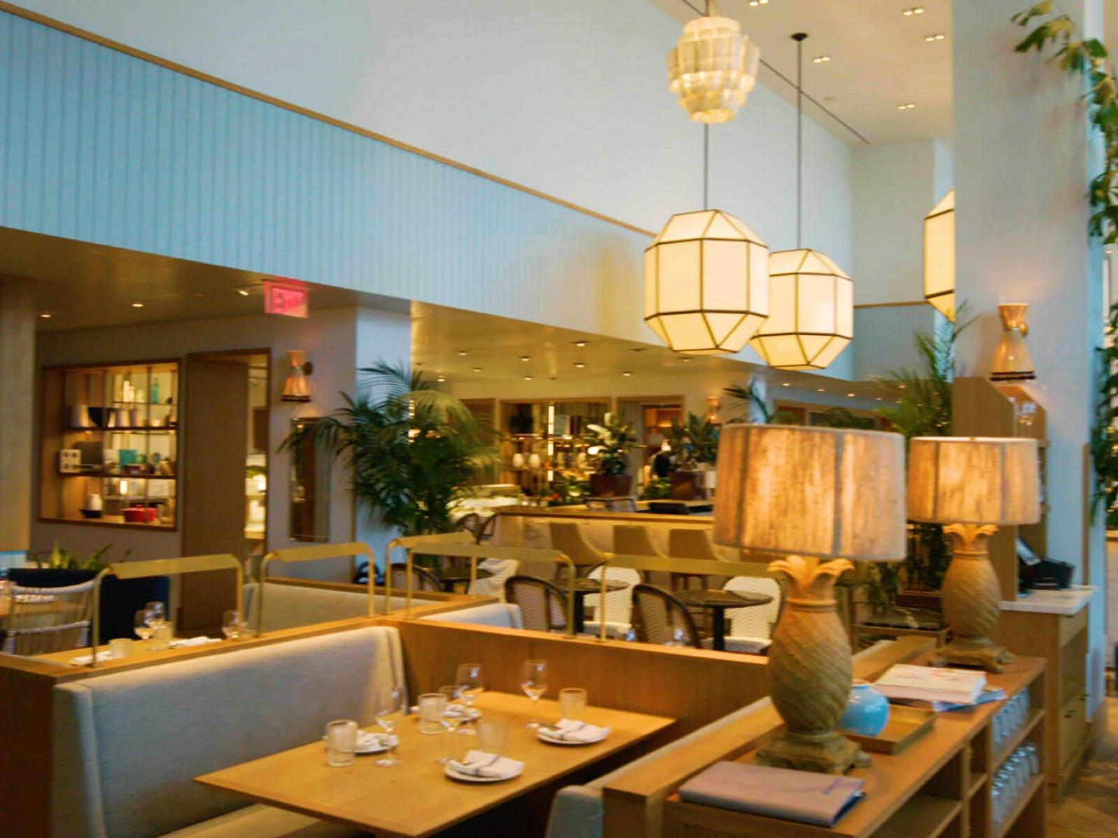 Overhead lamps provide mood lighting in hotel restaurant