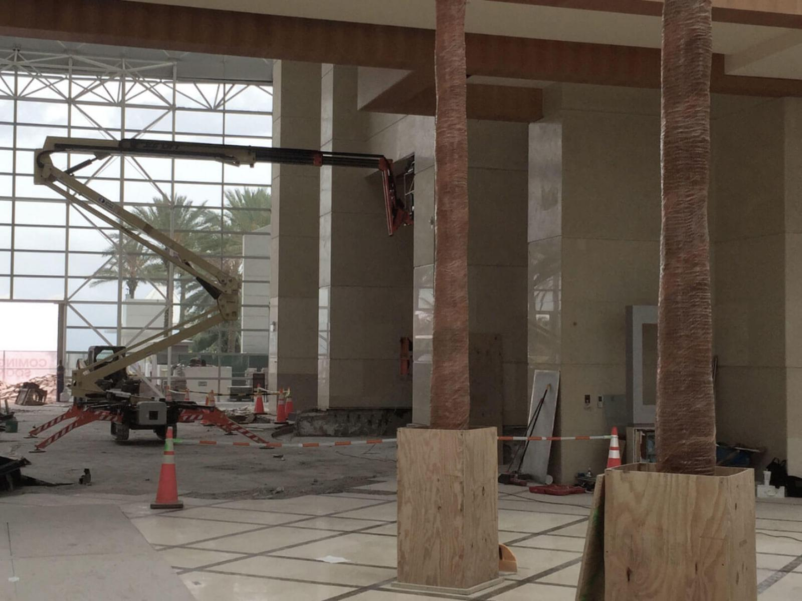 Pillars sheathed in protective covering in hotel lobby atrium under renovation